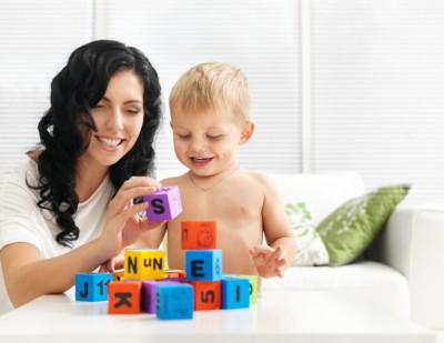 mother and toddler play with blocks